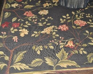 Spectacular dark brown base with cream, red and green floral design needlepoint area rug, 8' x 9'10'