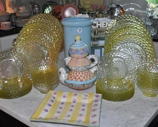 Wonderful yellow glass dinnerware sets (2 sets of 8) shown with Mackenzie Childs pottery