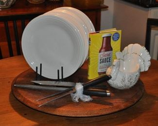 Ivory Fiestaware shown with Calphalon carving set and more kitchenware.