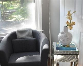 Lovely sitting area includes an Ikea grey Barrel Chair and one of the two petite mirrored side tables