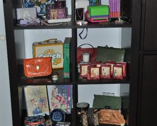 """Black IKEA 8-cube open shelf cabinet 31""""w x 59""""h x 15""""d shown with accessories from American Girl, Coach, Juicy Couture and more"""