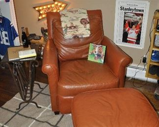 """Leather chair and ottoman from Lexington Home Brand. Chair measures 34""""w x 36""""h x 37""""d. The ottoman is 26.5""""w x 15""""h x 21""""d"""