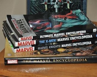 Collection of Marvel comic books and hardcover bookstore