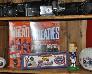 Cameras by Sony, Canon, FinePix and Vivitar zoom lenses with cases and more sport memorabilia