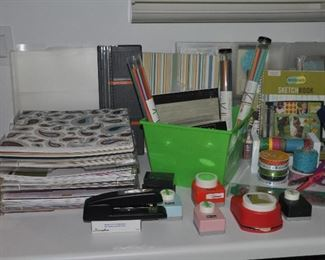 Unbelievable collection of scrapbooking supplies, including McGill paper cutters, kits for different subjects, ribbon and Fisker paper trimmers.