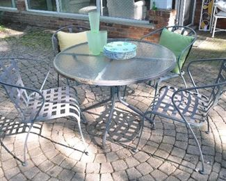 """Iron outdoor wrought iron/ glass dining table and chair set.  Table measures 41"""" x 28"""""""