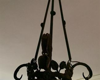 Scroll iron and glass Art Deco hanging light fixture.