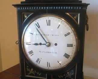 An  inlaid bracket clock, 19th century, the dial signed Hatfield and Hall Manchester, with side grilles and ring handles.