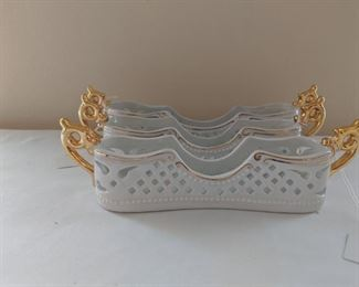 $15 each These white ceramic caddies feature elegant cut-out and embossed designs. There are two different designs available. One has embossed scroll pattern on the sides and has a beautiful geometric lace cut handles. The other design is a set of two in different sizes, and each has a geometric cut out lace design with gold color handles and details.  These white ceramic silverware holders are great for exquisitely decorating your party or wedding table. This is an excellent way to organize your party table, perfect for entertaining, kitchen countertop decor, dining table essentials. It is versatile item, so it could also make a great standing napkin holder, mail holder, unique flower vase/bowl, candy/nut bowl, etc! Perfect for anniversary, wedding, housewarming, or Mother's day gift.  *Please make sure these are the right size for your silverware/flatware set to hold in it.  • Condition: excellent, clean, no damages or discoloration