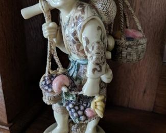Oxbone netsuke carved man carrying fruit