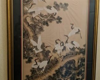 """$300 In Japan, the crane is a mythical creature and is believed to live for a thousand years. As a result, in the Japanese, Chinese and Korean culture, the crane represents good fortune and longevity. The Japanese refer to the crane as the """"bird of happiness"""".  This picture depicts a group of Manchurian Cranes, commonly called red-crowned cranes, standing on the top of a pine tree, light clouds in the foreground.   This gorgeous framed art measures 31.25 inches wide by 43.5 inches tall"""