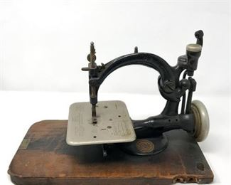 Wilcox & Gibbs Antique Sewing Machine   https://ctbids.com/#!/description/share/188242