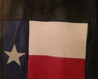 One motorcycle vest has a Texas flag on the back.