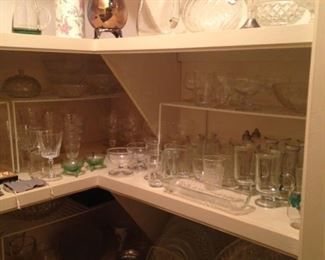 Many glasses, bowls, and other serving pieces