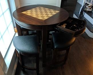Chess game table with nesting stools