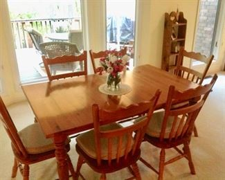 Dining Table w/6 Chairs in great condition.  There's a matching China Cabinet