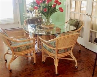 Rattan & Glass Table w/4 Rolling Chairs in great condition