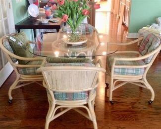 Another view of the Rattan/Glass Dining Table w/4 Rolling Chairs