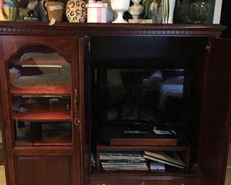 Cherry entertainment cabinet. $150
