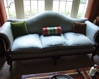 Antique Chinese chippendale camel back sofa with hand carved Rams head and hoofed foot