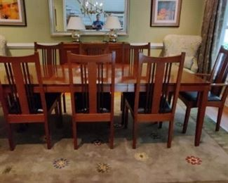 "Stickley metropolitan dining room table chairs and sideboard. All pieces in fantastic condition. Cherry wood.  H- 30"" W-42"" L-100 includes two leaves"