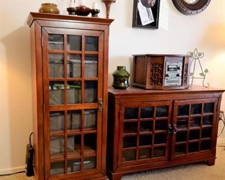 Cabinets in a cherry finish for books or storage or...