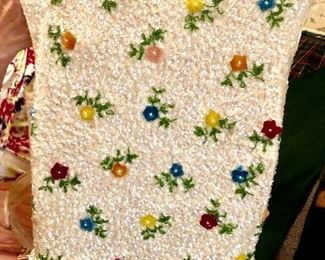 We all fell in love with this c 1953 evening top: All lined wool shell with ivory colored sequins accented with hand set beaded flowers, Truly exquisite about a size 8-10
