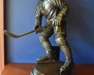 Bronze hockey player sculpture by Jim Davidson