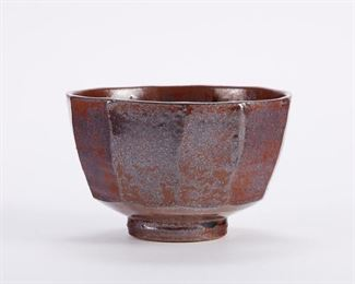 Warren MacKenzie (1924-2018). Cut-sided studio pottery ceramic bowl. Stoneware with an iridescent copper red glaze. Warren MacKenzie was a renowned Minnesota studio potter. A student of Bernard Leach and Shoji Hamada, he is credited with bringing the functional Mingei tradition to the United States, and spreading it through his own art and mentorship of students during his long tenure at the University of Minnesota. Note: Lots 1-19 were purchased by a single collector from MacKenzie's showroom between 1989-2000 SKU: 01407 Follow us on Instagram: @revereauctions