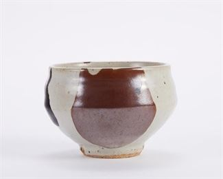 Warren MacKenzie (1924-2018). Studio pottery ceramic bowl. Stoneware with mottled glaze. Warren MacKenzie was a renowned Minnesota studio potter. A student of Bernard Leach and Shoji Hamada, he is credited with bringing the functional Mingei tradition to the United States, and spreading it through his own art and mentorship of students during his long tenure at the University of Minnesota. Note: Lots 1-19 were purchased by a single collector from MacKenzie's showroom between 1989-2000 SKU: 01389 Follow us on Instagram: @revereauctions