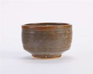 Warren MacKenzie (1924-2018). Studio pottery ceramic bowl. Stoneware with a gray-green glazed exterior and a cream glazed interior. Marked along the footrim. Warren MacKenzie was a renowned Minnesota studio potter. A student of Bernard Leach and Shoji Hamada, he is credited with bringing the functional Mingei tradition to the United States, and spreading it through his own art and mentorship of students during his long tenure at the University of Minnesota. Note: Lots 1-19 were purchased by a single collector from MacKenzie's showroom between 1989-2000 SKU: 01396 Follow us on Instagram: @revereauctions