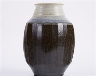 Warren MacKenzie (1924-2018). Studio ceramic pottery vase with fluted sides. Stoneware with gray, blue, and white glaze. Marked along the footrim. Warren MacKenzie was a renowned Minnesota studio potter. A student of Bernard Leach and Shoji Hamada, he is credited with bringing the functional Mingei tradition to the United States, and spreading it through his own art and mentorship of students during his long tenure at the University of Minnesota. Note: Lots 1-19 were purchased by a single collector from MacKenzie's showroom between 1989-2000 SKU: 01394 Follow us on Instagram: @revereauctions