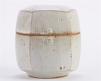 Warren MacKenzie (1924-2018). Lidded studio pottery ceramic box with a combed, cut-sided design. Glazed stoneware. Marked along the footrim. Warren MacKenzie was a renowned Minnesota studio potter. A student of Bernard Leach and Shoji Hamada, he is credited with bringing the functional Mingei tradition to the United States, and spreading it through his own art and mentorship of students during his long tenure at the University of Minnesota. Note: Lots 1-19 were purchased by a single collector from MacKenzie's showroom between 1989-2000 SKU: 01399 Follow us on Instagram: @revereauctions