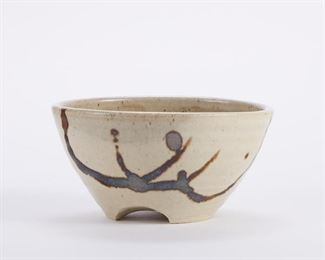 Warren MacKenzie (1924-2018). Studio pottery ceramic tripod bowl. Glazed stoneware. Marked along the foot. Warren MacKenzie was a renowned Minnesota studio potter. A student of Bernard Leach and Shoji Hamada, he is credited with bringing the functional Mingei tradition to the United States, and spreading it through his own art and mentorship of students during his long tenure at the University of Minnesota. Note: Lots 1-19 were purchased by a single collector from MacKenzie's showroom between 1989-2000 SKU: 01395 Follow us on Instagram: @revereauctions