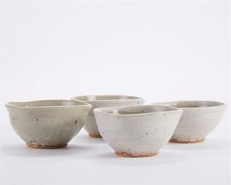 Warren MacKenzie (1924-2018). Set of four triangular studio pottery ceramic bowls. Stoneware with white glazed exteriors and gray glazed interiors. All are marked along the footrim. Warren MacKenzie was a renowned Minnesota studio potter. A student of Bernard Leach and Shoji Hamada, he is credited with bringing the functional Mingei tradition to the United States, and spreading it through his own art and mentorship of students during his long tenure at the University of Minnesota. Note: Lots 1-19 were purchased by a single collector from MacKenzie's showroom between 1989-2000 SKU: 01402 Follow us on Instagram: @revereauctions