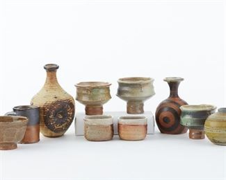 """Group of ten pieces of Minnesota studio pottery, including three vases, three tea bowls, one mug, one bowl, and two small dishes. Several marked: two of the vases are signed Nelson under the base, and dated '79 and '84, respectively; the tallest vase is signed Eckels under the base; two of the three tea bowls are marked with a """"K"""" mark; the mug is marked with a """"W"""" along the footrim; and the two small dishes are illegibly signed under the base.  SKU: 01814 Follow us on Instagram: @revereauctions"""