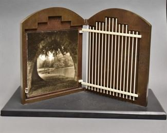 Irve Dell (20th/21st c) and Lynn Geesaman (b. 1938). Untitled metal sculpture with photograph. Bronze form with leaves in low relief open to display a gate over a photograph depicting a garden.  SKU: 01969 Follow us on Instagram: @revereauctions