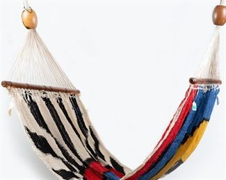 """After Alexander Calder (1898-1976). Hammock soft sculpture. Cotton cord and jacaranda. Signed and dated '75 in the weave. The fabric manufacturer's label on the reverse reads: """"Content: 100% Cotton Manila Size: Name: Hammock, Soft Sculpture Edition No: (11/100) Original Design by: Alexander Calder Date: 1975 Made in: Nicaragua CAC Publication, N.Y.C.""""  SKU: 01412 Follow us on Instagram: @revereauctions"""