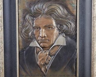 """Bill Mack (b. 1949). Bronze bas relief wall sculpture depicting Ludwig von Beethoven with the text """"the gracious mouth through which music spoke."""" Signed along the upper right.  SKU: 01767 Follow us on Instagram: @revereauctions"""
