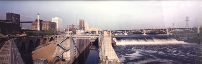 Stuart Klipper (b. 1941). Color coupler print photograph of a panoramic view of downtown Minneapolis over the Mississippi with the Stone Arch Bridge. 1988.  SKU: 01980 Follow us on Instagram: @revereauctions