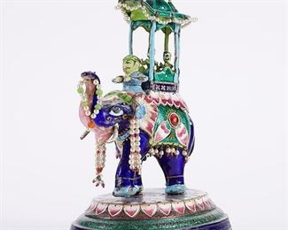 Early 20th century Indian enameled silver sculpture of an elephant with riders. Heavily decorated with fine details. SKU: 01371 Follow us on Instagram: @revereauctions