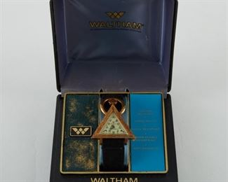 """Waltham, USA. Masonic wristwatch. Gold-filled triangular body with stainless steel back. 17 Jewel. Cream dial with painted masonic symbols and mottoes; additionally marked """"Waltham 17 Jewels."""" Original Waltham band. With original box. SKU: 01910 Follow us on Instagram: @revereauctions"""