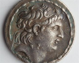 Demetrios I coin, Seleucid empire, c. 162-150 BCE. The obverse shows the profile of Demetrios I with a diadem; the reverse shows Athena flanked by a Greek inscription and encircled with laurel. SKU: 01347 Follow us on Instagram: @revereauctions