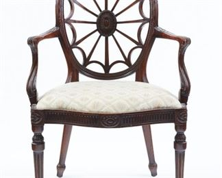 20th c. George III style wheel back open armchair. The chair features carved floral accents and cream floral upholstery.  SKU: 01895 Follow us on Instagram: @revereauctions