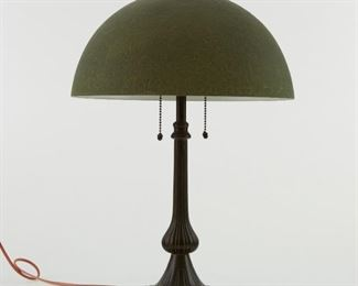 """Handel Mosserine Arts and Crafts lamp. Patinated bronze base with textured green glass shade. The bronze ring at the top of the shade is marked """"Handel Lamps, Pat'd. No. 979664."""" Marked on the interior of the shade: """"'Handel' Mosserine"""" and """"U.S. Patent No. 97966, No. 775818."""" Further impressed with """"5384.""""  SKU: 01413 Follow us on Instagram: @revereauctions"""