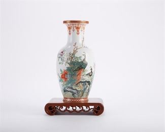 20th century Chinese porcelain vase, decorated with peacocks among flowers. Marked under the base. With carved wooden stand.  SKU: 01373 Follow us on Instagram: @revereauctions