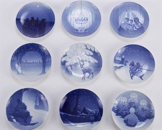 Bing and Grondahl, Denmark. Group of nine blue and white porcelain Christmas Eve (Jule Aften) plates, dating from 1901 to 1909.  SKU: 01356 Follow us on Instagram: @revereauctions