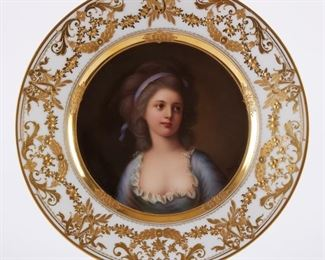 """19th century Dresden painted porcelain plate depicting a young woman in 18th century garb. The painting is signed along the lower right. The plate is marked on the underside in blue and gold, and additionally inscribed """"Potoka"""" and """"D. 336."""" and a blue crossed swords mark, similar to Meissen.  SKU: 01227 Follow us on Instagram: @revereauctions"""