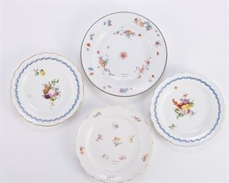Group of four 18th and 19th c. Meissen porcelain plates. All hand painted with floral and fruit motifs. Three with gilded edges. All marked with the Meissen crossed swords mark in underglaze blue along the underside.  SKU: 01286 Follow us on Instagram: @revereauctions