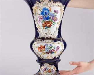 """Large porcelain vase by Meissen, Germany. Cobalt blue body with gilded accents and floral reserves with scrolling borders. Marked with the Meissen crossed swords marks under the base. Additionally inscribed """"2757"""" and """"20.""""  SKU: 01300 Follow us on Instagram: @revereauctions"""